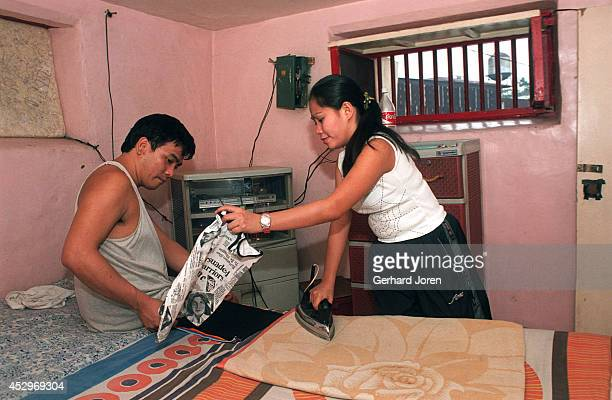 Mary Jane Palima and her boyfriend Anthony Chiu iron their laundry in their VIP cell at the Sputnik gang barrack at the Manila City Jail Sputnik is...