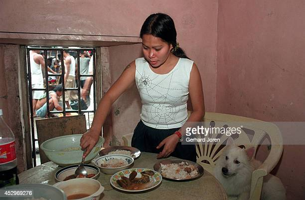 Mary Jane Palima cleaning up after lunch with her boyfriend Anthony Chiu in their VIP cell at the Sputnik gang barrack at the Manila City Jail...