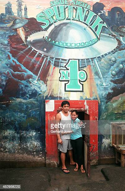 Mary Jane Palima with her boyfriend Anthony Chiu at the door of their VIP cell at the Sputnik gang barrack at the Manila City Jail. Sputnik is one of...