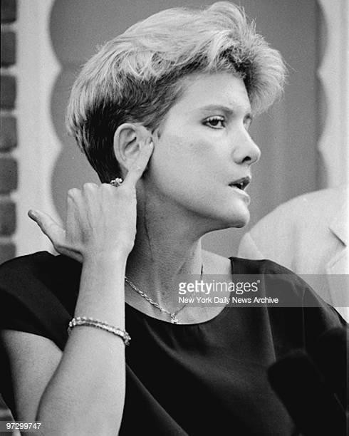 Mary Jo Buttafuoco points to her bullet wound at her lawyer's office