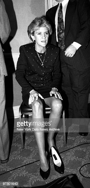 Mary Jo Buttafuoco takes time to rest her feet during press conference at the Island Inn