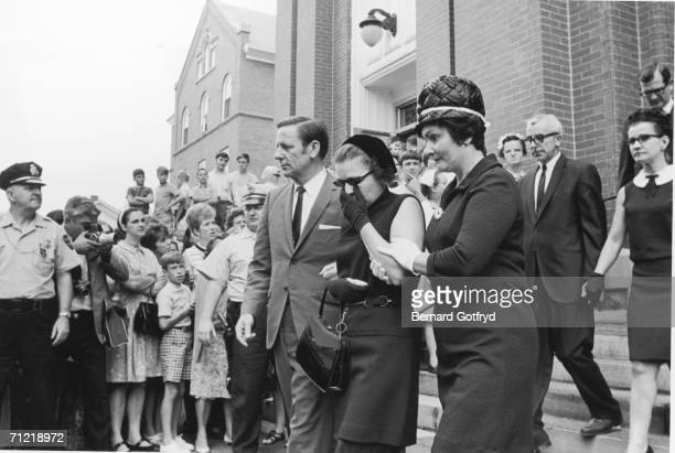 Mary Jo Kopechne's parents Joseph and Gwen walk down the steps past other mourners and spectators of St Vincent's Roman Catholic Church after...