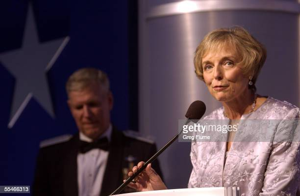Mary Jo Myers speaks to the crowd as her husband General Richard B. Myers looks on at the USO Gala on September 14, 2005 at the Hilton Washington in...