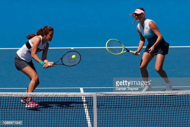 Mary Joe Fernandez of the United States plays a forehand in her Women's Legends Doubles match with Barbara Schett of Austria against Martina...