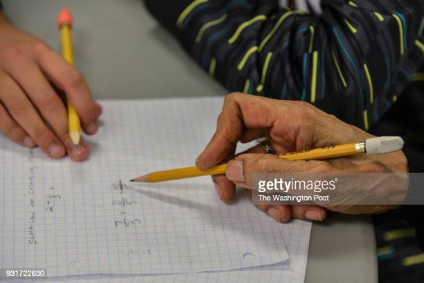 Mary Johnson an 81yearold educator in the District demonstrates her simple mathematics diagnostic test on Mason Edmond L at the Washington Tennis and...
