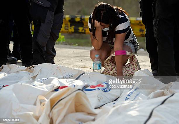 Mary Joy Ducusin reacts as she finds her missing six year old son British citizen Jairo Ben among the bodies brought to one of three mass burial...