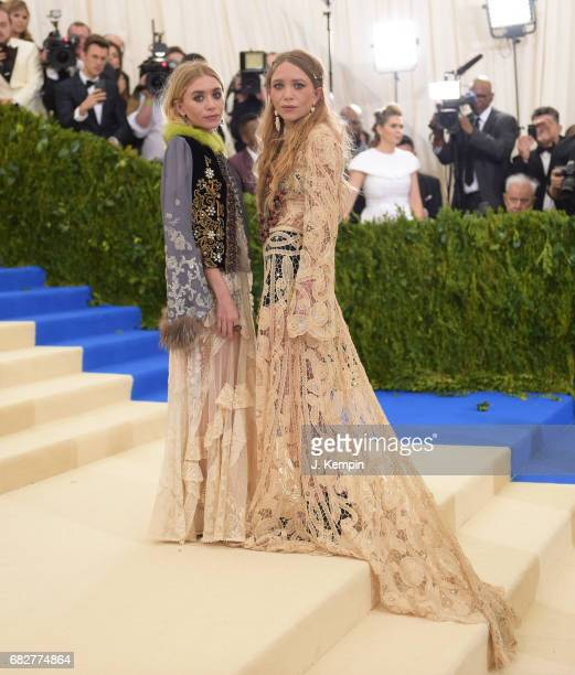 Mary Kate Olsen and Ashley Olsen attend the 'Rei Kawakubo/Comme des Garcons Art Of The InBetween' Costume Institute Gala at Metropolitan Museum of...