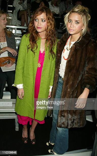 Mary Kate Olsen and Ashley Olsen during Olympus Fashion Week Spring 2005 Marc Jacobs Front Row at Pier 54 in New York City New York United States