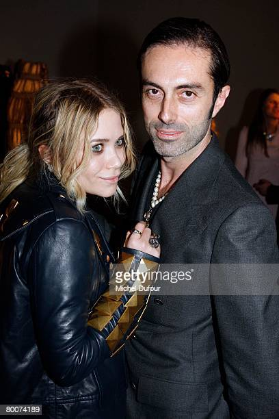 Mary Kate Olsen and Giambattista Valli attends the Moncler Fashion show, gamme Rouge, designed by Giambattita Valli, during Paris Fashion Week...