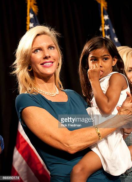 Mary Kaye Huntsman with her adopted daughter Asha age 5 at her husband's former Utah Governor Jon Huntsman Jrs announcement of his presidential...