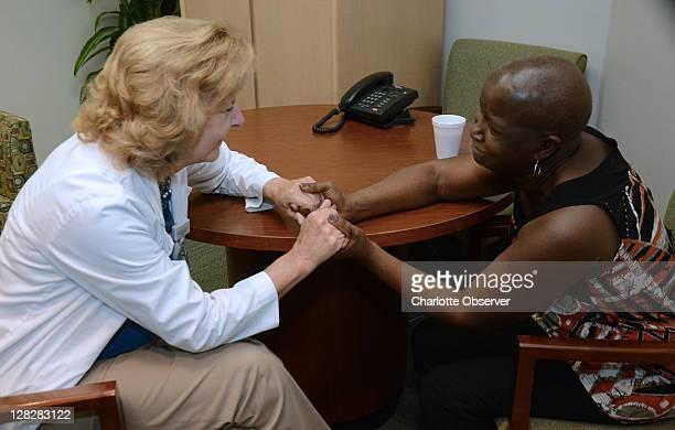 Mary Keefe left gets heartfelt thanks from cancer patient Joy Wells at Presbyterian Hospital in Charlotte North Carolina on September 21 2011 Keefe...