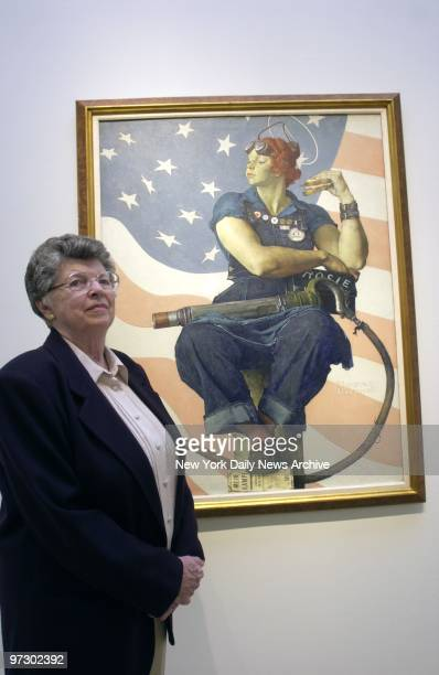 """Mary Keefe stands next to Norman Rockwell's painting """"Rosie the Riveter"""" at Sotheby's auction house. Keefe was a nineteen-year-old telephone operator..."""