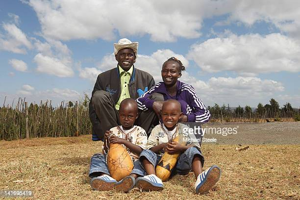 Mary Keitany of Kenya and winner of the 2011 London Marathon poses for a portrait with husband and coach Charles Koechson Jared Kipchumba and his...