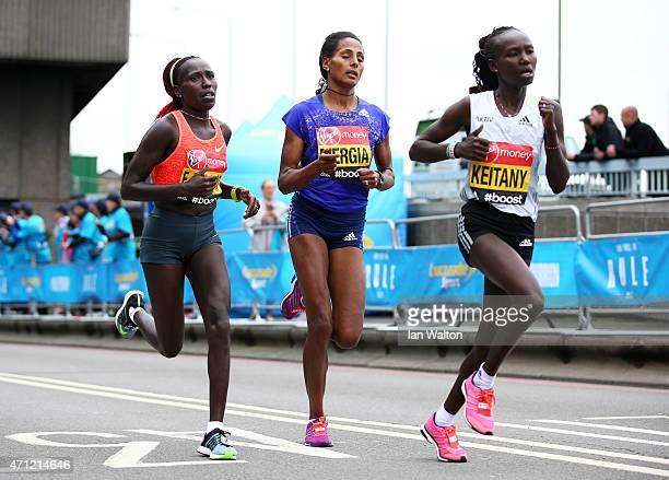 Mary Keitany of Kenya Aselefech Mergia of Ethiopia and Florence Kiplagat of Kenya compete during the Virgin Money London Marathon on April 26 2015 in...