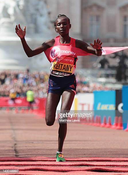 Mary Keitany of Kenya celebrates winning the Womens Elite race during the Virgin London Marathon 2012 on April 22 2012 in London England