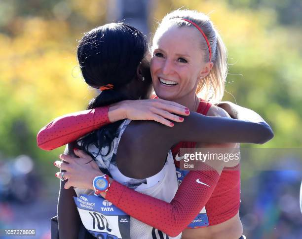 Mary Keitany of Kenya congratulates Shalane Flanagan of the USA after during the 2018 TCS New York City Marathon on November 4, 2018 in Central Park...