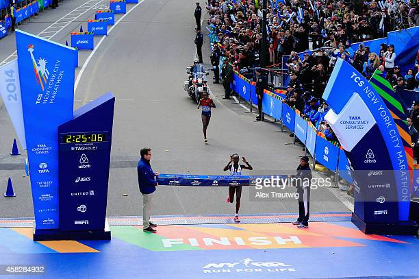 Mary Keitany of Kenya crosses the finish line to win the Pro Women's division during the 2014 TCS New York City Marathon in Central Park on November...