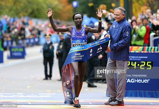 Mary Keitany of Kenya crosses the finish line to win the Pro Women's division during the 2015 TCS New York City Marathon in Central Park on November...