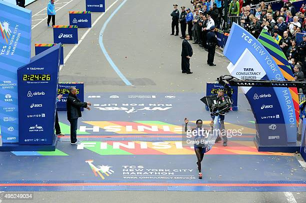 Mary Keitany of Kenya crosses the finish line to win the Pro Women's division at TAG Heuer Official Timekeeper and Timepiece of 2015 TCS New York...