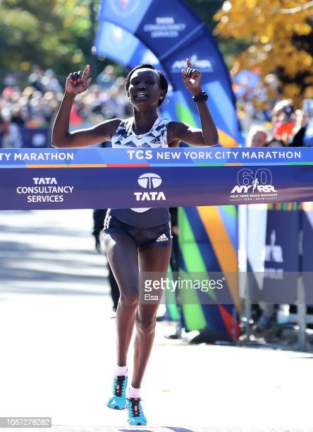 Mary Keitany of Kenya crosses the finish line to win the Women's Division of the 2018 TCS New York City Marathon on November 4 2018 in Central Park...