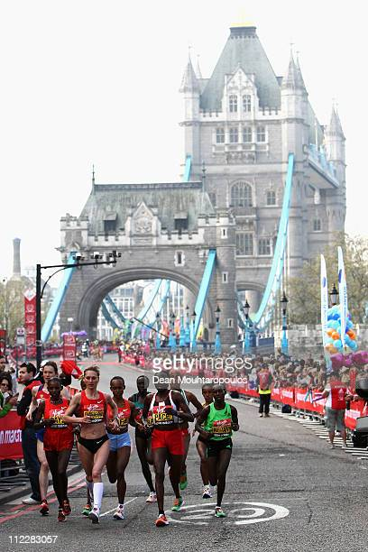 Mary Keitany of Kenya, Liliya Shobukhova of Russia and Edna Kiplagat of Kenya run over Tower Bridge during the Virgin London Marathon 2011 on April...