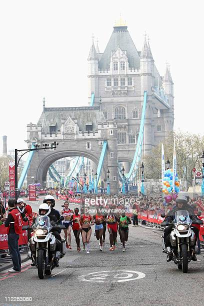 Mary Keitany of Kenya, Liliya Shobukhova of Russia and Edna Kiplagat of Kenya run over Tower Bridge follow the motorcycle during the Virgin London...