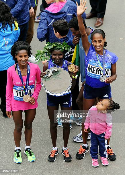 Mary Keitany of Kenya poses alongside second place Aselefech Mergia of Ethiopia and third place Tigist Tufa of Ethiopia after the trophy presentation...