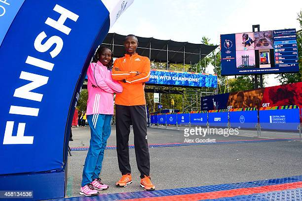 Mary Keitany poses for a picture with Geoffrey Mutai at the TCS New York City Marathon finish line on October 30 2014 in New York City