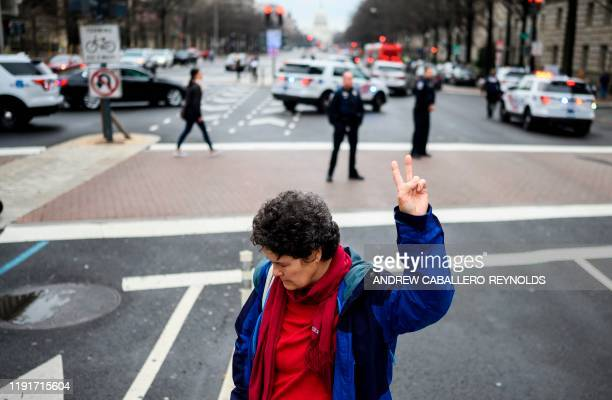Mary Kepferlean antiwar activist demonstrates outside the Trump International Hotel in Washington DC on January 4 2020 Demonstrators are protesting...