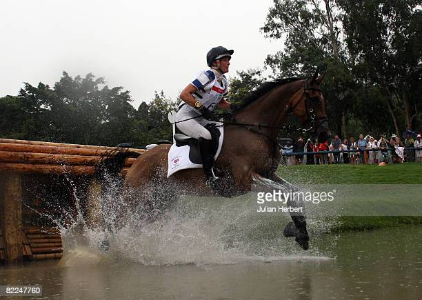 Mary King of Great Britain and Call Again Cavalier go through the water jump during the Eventing Cross Country event held at the Hong Kong Olympic...