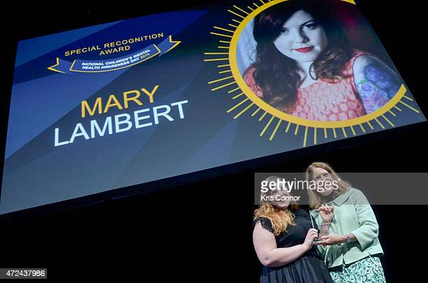 Mary Lambert is presented with an award by US Department of Health and Human Services Secretary Sylvia Mathews Burwell during the 10th Anniversary Of...