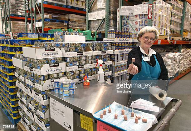 Mary LaRocca offers a sample of Libby's Vienna Sausage in a Costco Wholesale store March 8 2002 in Niles IL Warehouse retailer Costco Wholesale Corp...