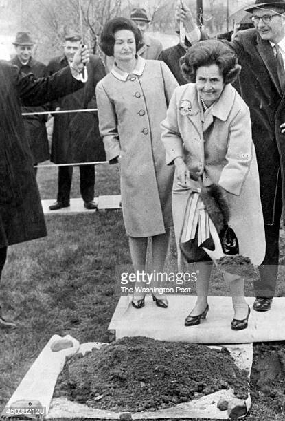 FILE Mary Lasker turns a ceremonial spadeful of earth in East Potomac Park in Washington DC on April 24 1966 Behind her Mrs Lyndon Johnson and...