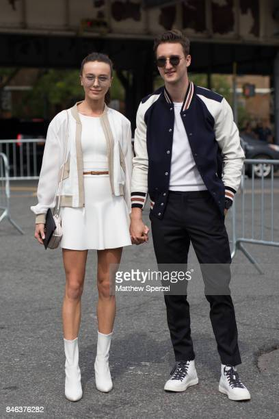 Mary Leest and Marcel Floruss are seen attending Coach during New York Fashion Week wearing varsity jackets on September 12 2017 in New York City