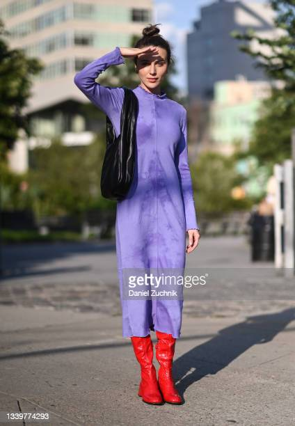 Mary Leest is seen wearing a purple Jonathan Simkhai dress and red boots outside the Jonathan Simkhai show during New York Fashion Week S/S 22 on...