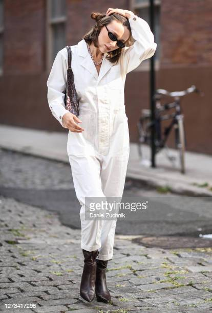 Mary Leest is seen wearing an Alex Mill jumpsuit Tiffany necklace Staud bag and Tony Bianco boots during New York Fashion Week S/S21 on September 18...