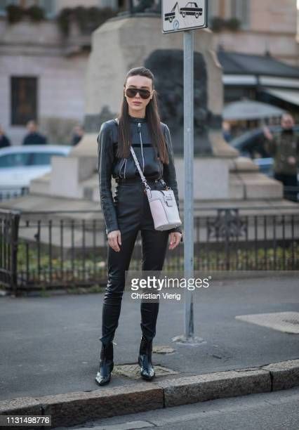 Mary Leest is seen wearing black zipped jacket pants white bag outside Tods on Day 3 Milan Fashion Week Autumn/Winter 2019/20 on February 22 2019 in...
