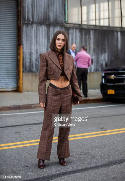 Mary Leest is seen wearing brown cropped checkered blazer jacket and pants outside Michael Kors during New York Fashion Week September 2019 on...