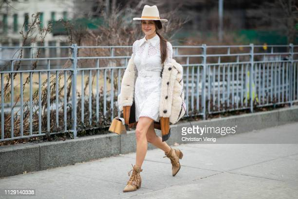 Mary Leest is seen wearing cowboy hat white dress outside Zimmermann during New York Fashion Week Autumn Winter 2019 on February 11 2019 in New York...