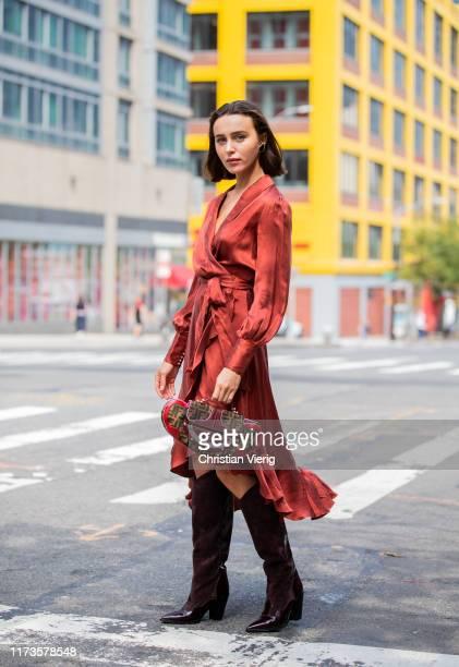 Mary Leest is seen wearing Fendi bag silk dress bordeaux boots outside Zimmermann during New York Fashion Week September 2019 on September 09 2019 in...