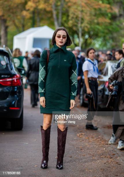 Mary Leest seen wearing green zipped dress, bordeaux boots outside Lacoste during Paris Fashion Week Womenswear Spring Summer 2020 on October 01,...