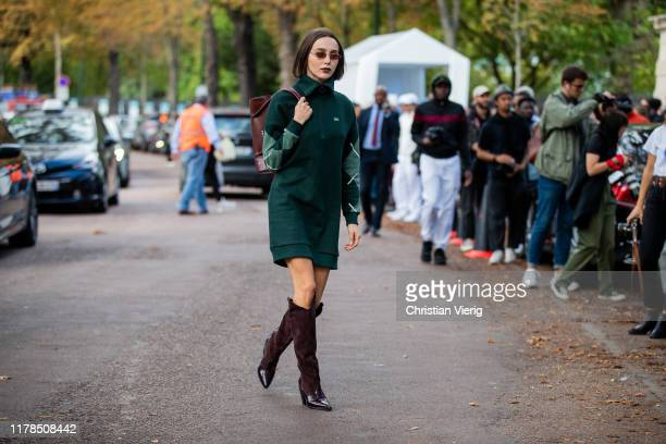 Mary Leest seen wearing green zipped dress bordeaux boots outside Lacoste during Paris Fashion Week Womenswear Spring Summer 2020 on October 01 2019...