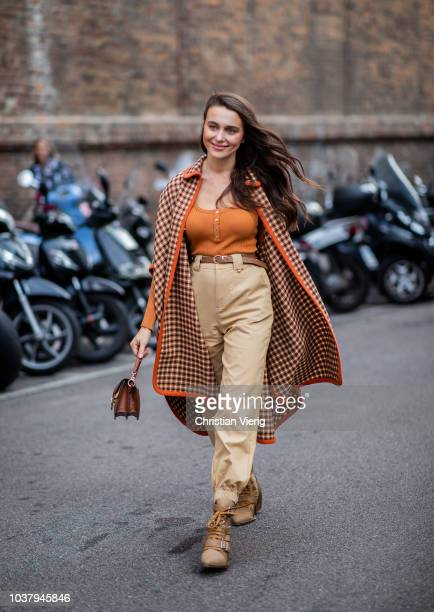 Mary Leest wearing beige high waist pants coat orange top is seen outside Blumarine during Milan Fashion Week Spring/Summer 2019 on September 21 2018...