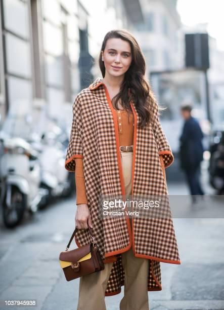 Mary Leest wearing beige high waist pants coat orange top is seen outside Blumarine during Milan Fashion Week Spring/Summer 2019 on September 21 2018...