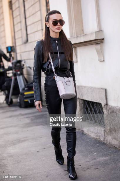 Mary Leest wearing black zipped jacket pants and white bag is seen outside Tod's on Day 3 Milan Fashion Week Autumn/Winter 2019/20 on February 22...