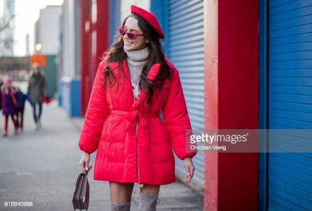 Mary Leest wearing red beret turtleneck red puffer jacket overknees boots seen outside Creatures of Comfort on February 8 2018 in New York City