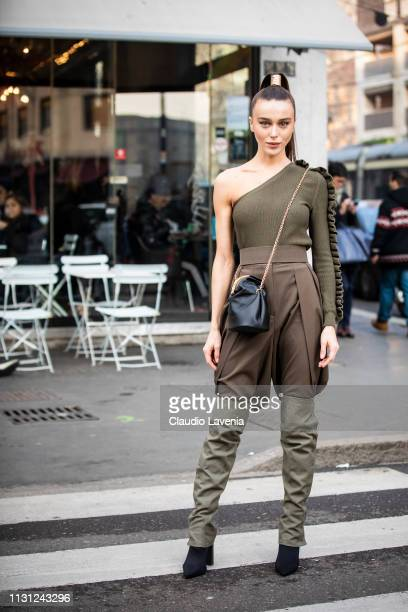 Mary Leest wearing ripped off top brown olive two tone pants and black bag is seen outside Max Mara on Day 2 Milan Fashion Week Autumn/Winter 2019/20...