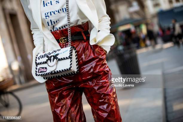 Mary Leest wearing white jacket Gucci belt red snake print pants and Pinko bag is seen outside Stella Jean on Day 5 Milan Fashion Week Autumn/Winter...