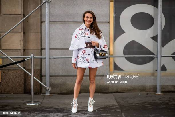 Mary Leest wearing white jacket with belt is seen outside Tibi during New York Fashion Week Spring/Summer 2019 on September 9 2018 in New York City