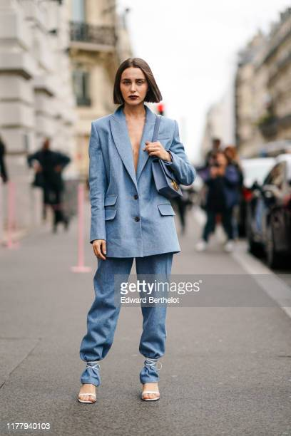 Mary Leest wears a blue oversized blazer jacket pants a blue bag outside Ralph Russo during Paris Fashion Week Womenswear Spring Summer 2020 on...